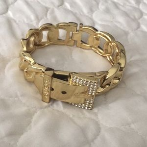 Gold toned hinged bracelet